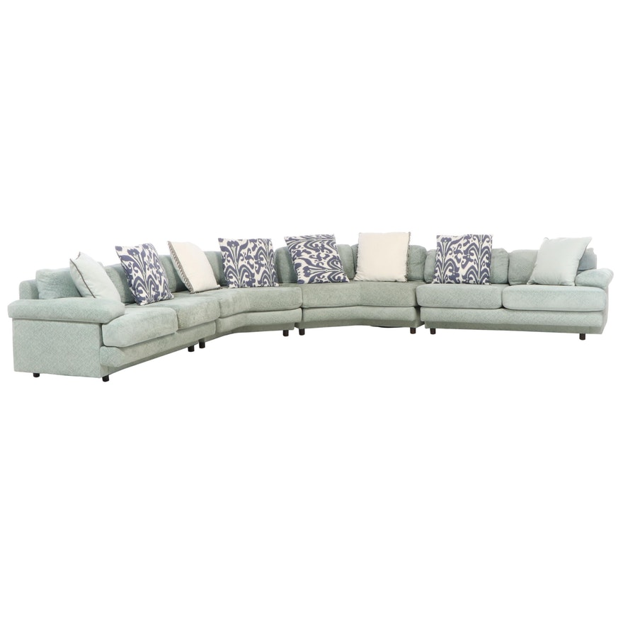 Upholstered Four-Piece Sectional with Accent Pillows