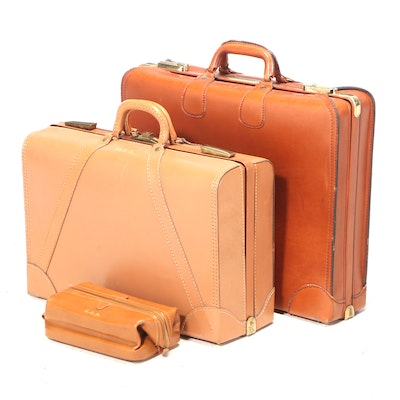 "Two Cowhide Suitcases Plus Dop Kit, Monogrammed ""H.E.S."""