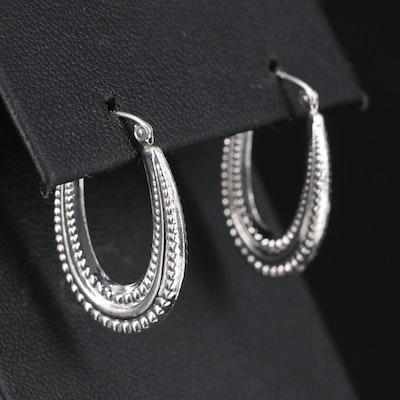 14K Elongated Hoop Earrings with Granulated Design