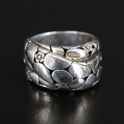 Sterling Silver Textured Crossover Ring with Flower Accents