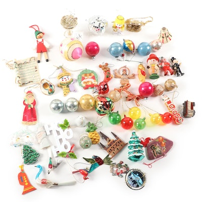 Glass Christmas Ornaments Including Bear, Angel, Pinnochio, and More