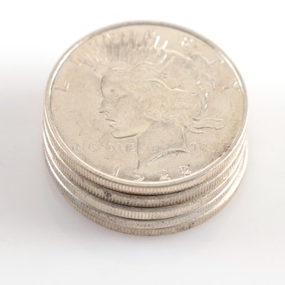 Five 1922 Peace Silver Dollars