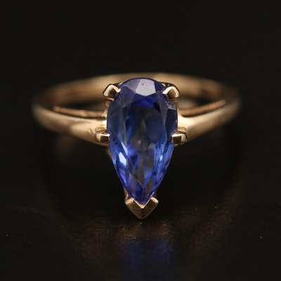14K Tanzanite Ring Featuring Cathedral Setting