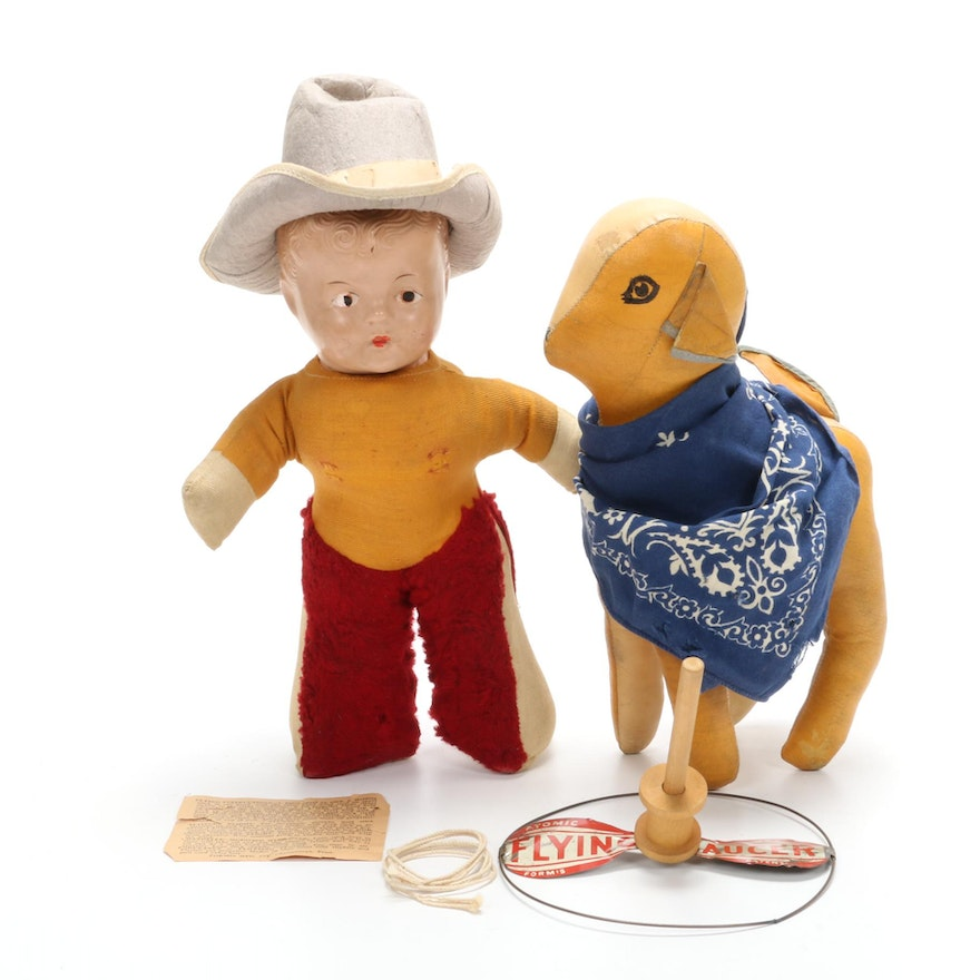 "Composite Cowboy Doll with Stuffed Vinyl Dog and Formis ""Flying Saucer"" Toy"