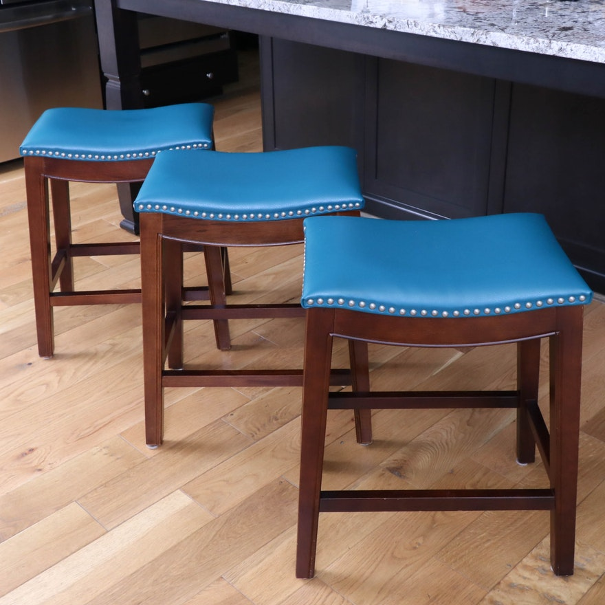Three Teal Upholstered Counter-Height Stools with Nailhead Trim