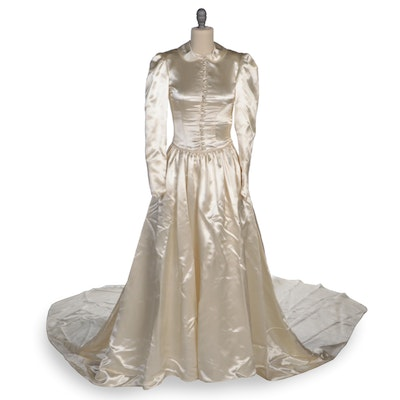 Ivory Satin Long Sleeved Wedding Gown with Fitted Bodice and Includes Veil