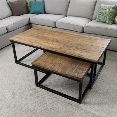 Two Industrial Style Distressed Wood and Metal Nesting Coffee Tables