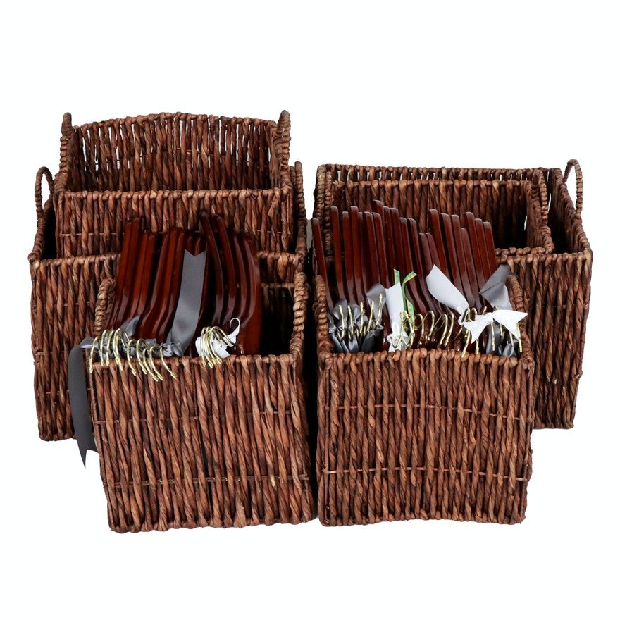 Woven Rattan Storage Baskets with Cherry-Stained Wooden Shirt Hangers