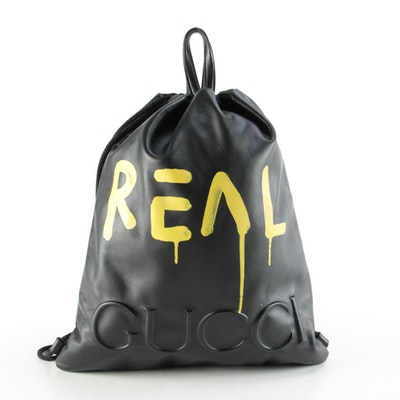 Gucci Embossed GucciGhost Drawstring Backpack in Black Leather