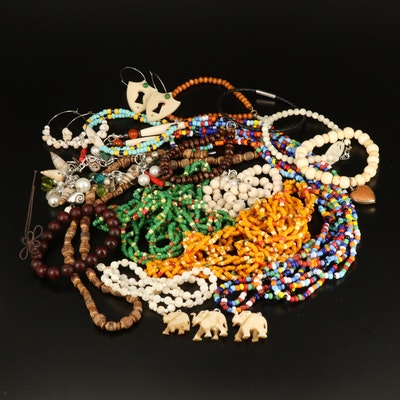 Beaded Jewelry with Carved Elephant Pendants and Shell Charms