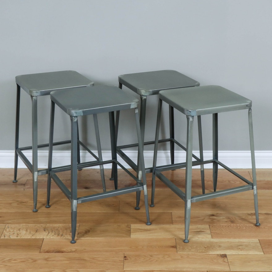 Four CB2 Industrial Style Metal Counter-Height Stools