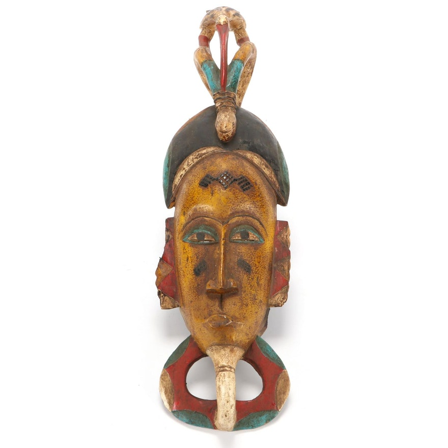 Guro Style Polychrome Wood Mask with Animal Motif, Cote d'Ivoire