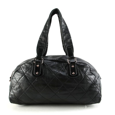 Chanel Quilted Cruise Bowler Bag in Black Lambskin Leather