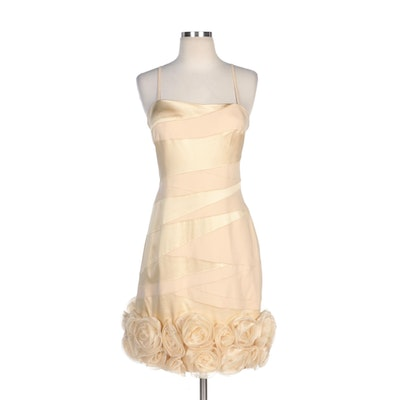 Alberto Makali Ivory Sleeveless Occasion Dress with Embellished Rosette Hemline