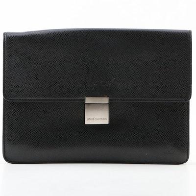 Louis Vuitton Pochette Selenga Clutch Wristlet in Black Taiga Leather