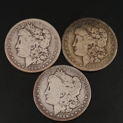 1884-O and a Pair of 1889-O Morgan Silver Dollars