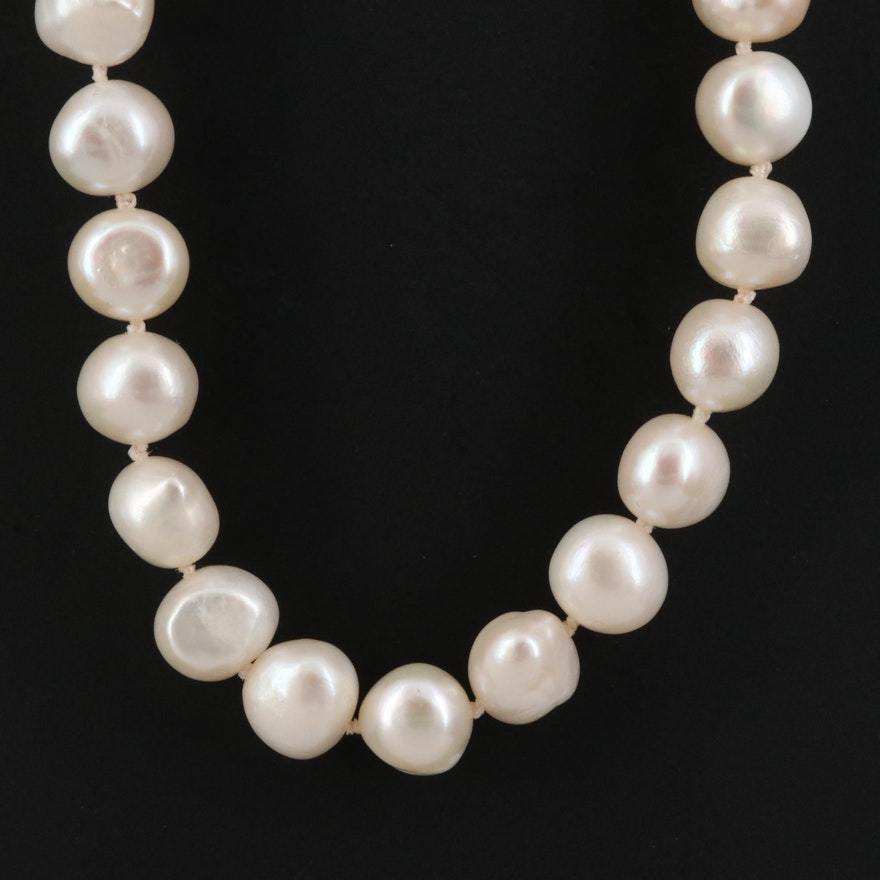 Knotted Strand of Semi-Baroque Pearls with 14K Clasp