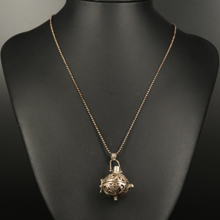 Open Scrollwork Necklace with Rattle Ball