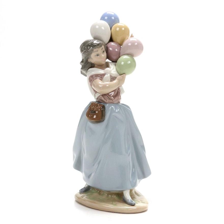 """Lladró """" Balloon Seller"""" Porcelain Figurine Designed by Vicente Martínez"""