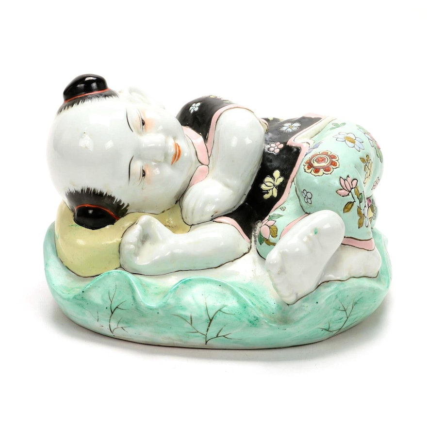 Chinese Porcelain Figurine of Baby Girl Resting