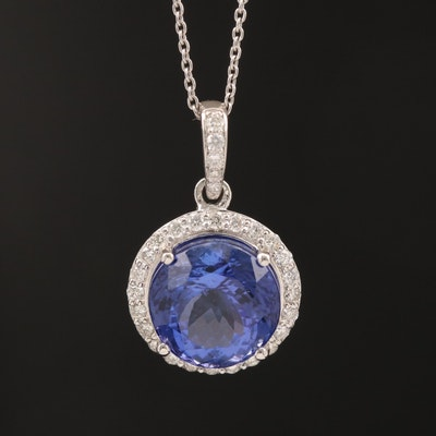 Platinum 7.59 CT Tanzanite and Diamond Halo Ring