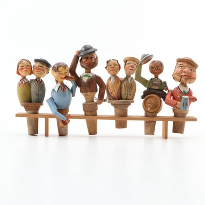 Six German Folk Art Carved Wooden Wine Bottle Stoppers with Shelf