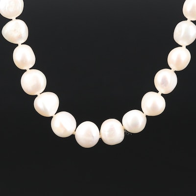 Strand of Semi-Baroque Pearls with 14K Clasp