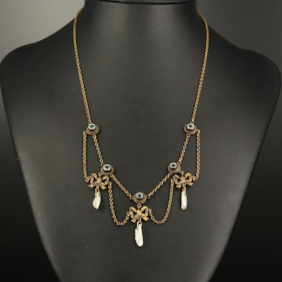 Circa 1900 Bow Festoon Necklace with Glass and Dogtooth Pearls