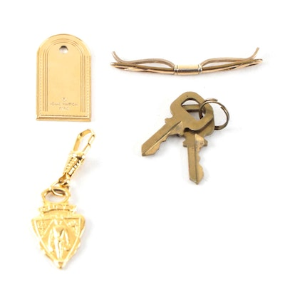 Louis Vuitton Charm and Keys, Gucci Zipper Pull and Hadley Tie Clip