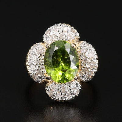 14K Oval Peridot Ring with Diamond Encrusted Petals