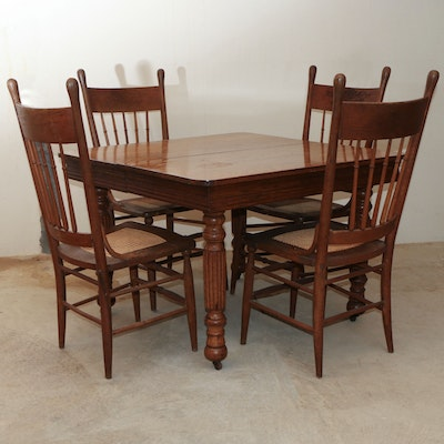 American Primitive Oak Extendable Dining Table and Caned Chairs