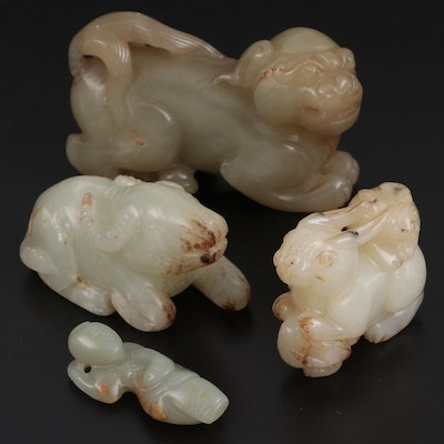 East Asian Serpentine Guardian Lion, Child, Rabbit, and Water Buffalo  Figurines