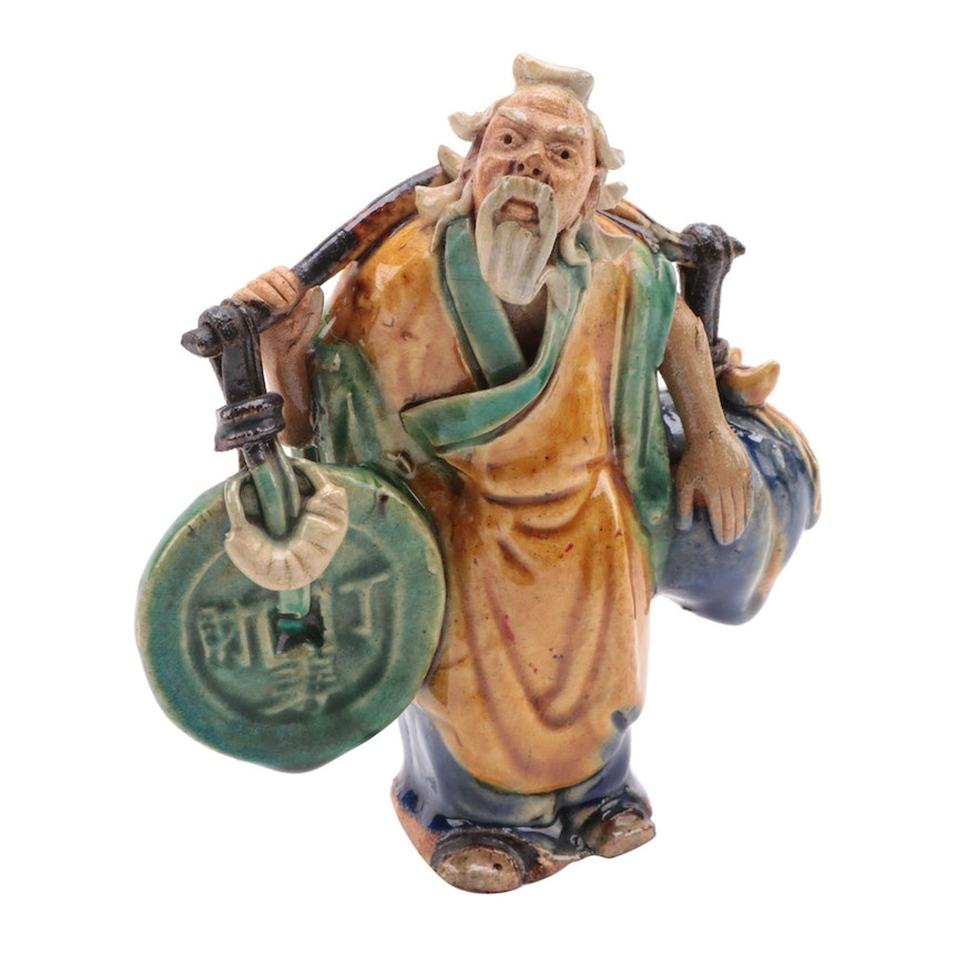 Chinese Schiwan Ware Figurine of Immortal Carrying Coins and Fruit