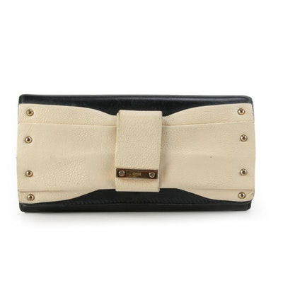 Chloè June Bow Embellished Folio Wallet in Black and Ivory Leather