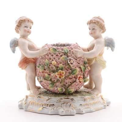Dresden Style Porcelain Putti Holding a Flowered Bowl, Mid-20th Century