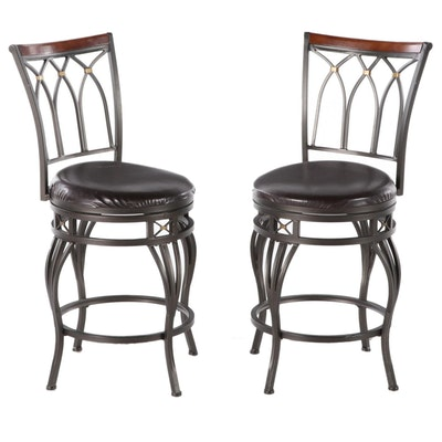 Pair of Cheyenne Ind. Hardwood-Mounted and Patinated Metal Swivel Bar Stools