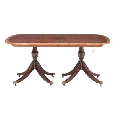 Baker Furniture Classical Style Mahogany and Crossbanded Extending Dining Table