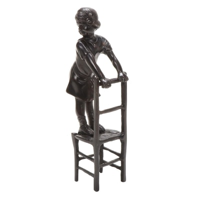 Bronze Sculpture of a Girl on Chair