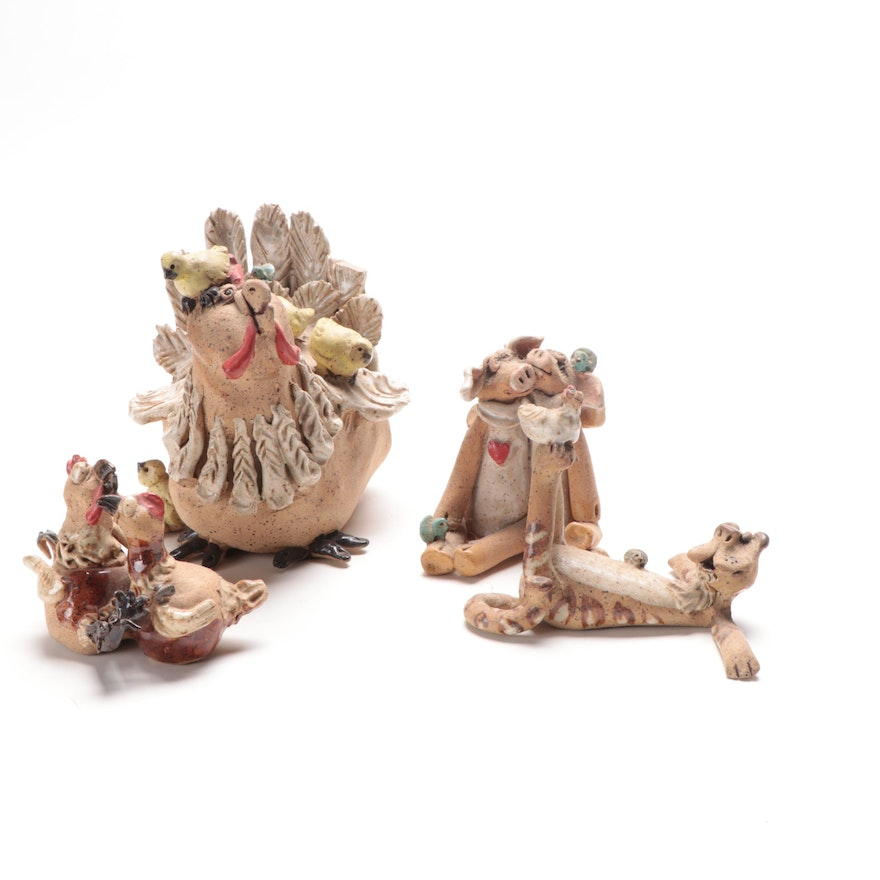 Four Whimsical Pottery Figurines
