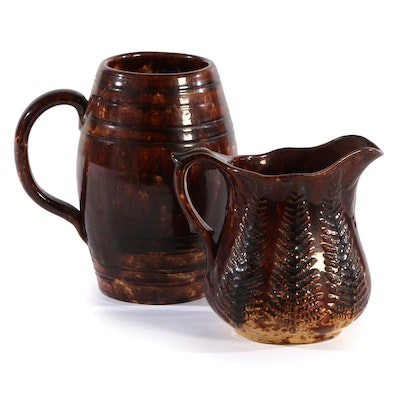 Bennington Glaze Splattered Yellowware Fern, and Barrel Shaped Pitchers