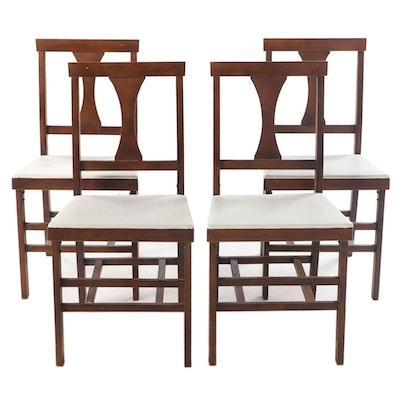 Four Mid Century Modern Walnut-Stained and White Vinyl Folding Side Chairs