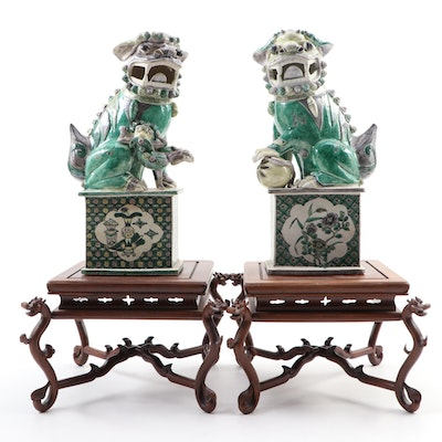 Pair of Chinese Porcelain Guardian Lions on Carved Wood Stands