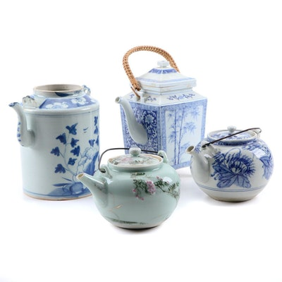Four Chinese Hand-Painted Porcelain and Ceramic Teapots