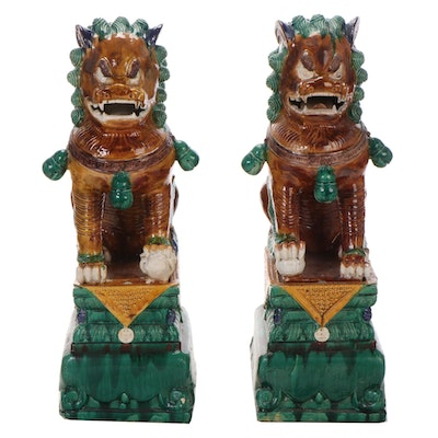 Pair of Chinese Sancai Glaze Ceramic Guardian Lions on Stands
