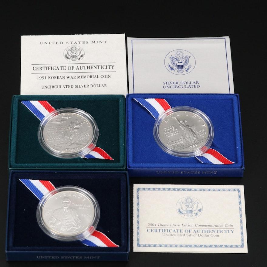 Three Uncirculated Modern Commemorative Silver Dollars