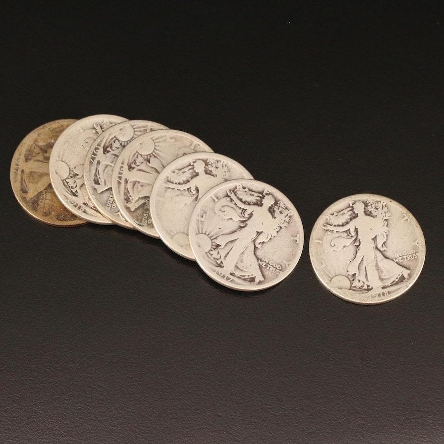 Seven Early Walking Liberty Silver Half Dollars