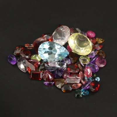 Loose 51.81 CTW Gemstones Including Ruby, Topaz and Garnet