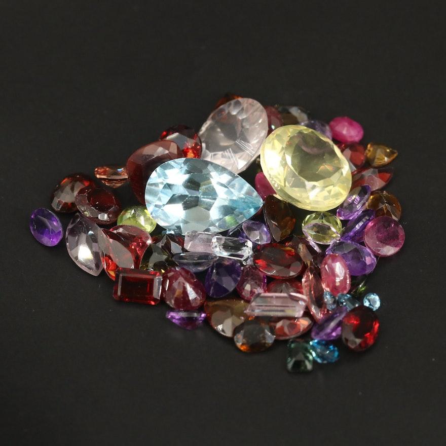 Loose 51.81 CTW Gemstones Including Ruby, Topaz and Garnet