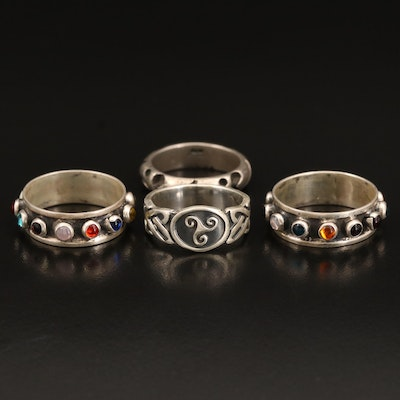 Sterling Rings Including Celtic Triskelion, Glass and Scrolling Band