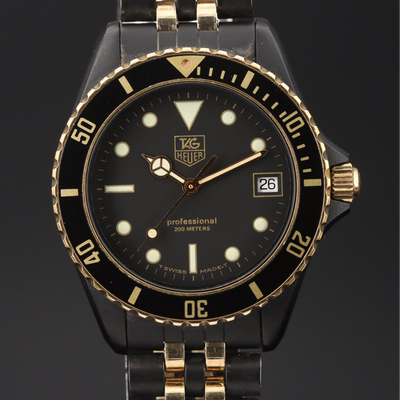 "TAG Heuer ""1000"" Black and Gold Tone Quartz Wristwatch"